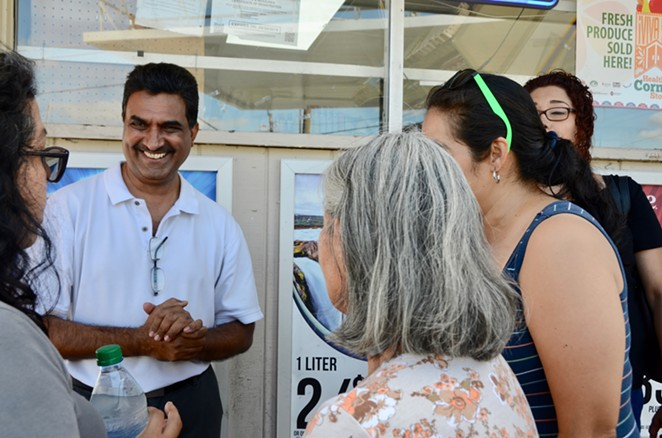 Gas N' Go Owner Shaukat Momin visits with residents outside his store on Wednesday, Sept. 25, 2019. - LEA THOMPSON