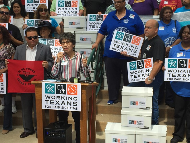 AFL-CIO's Linda Chavez Thompson fires up the crowd in front of City Hall last year after Working Texans for Paid Sick Time delivered its signed petitions to city officials. - SANFORD NOWLIN