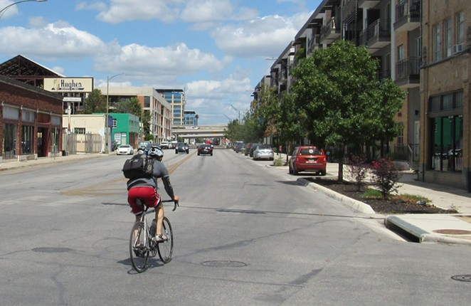 A cyclist pedals north from downtown on Broadway. - SANFORD NOWLIN