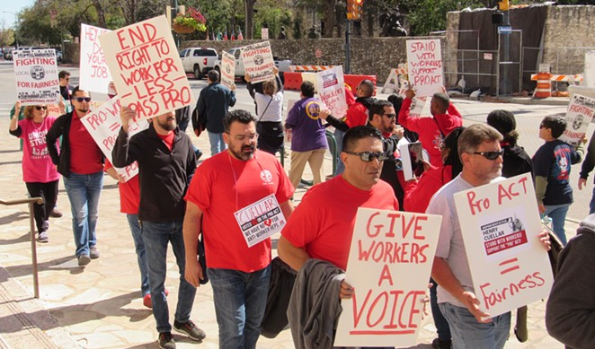 Communications Workers of America members stage a protest in front of the downtown San Antonio office of U.S. Rep. Henry Cuellar. - SANFORD NOWLIN