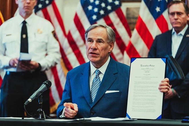 Gov. Greg Abbott shows off an executive order during a recent press conference. - INSTAGRAM / @GOVERNORABBOTT