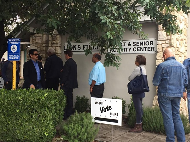 Voters waited in line to cast their ballots at Lion's Field in San Antonio during the 2018 midterms. Voting rights groups argue that people should be allowed to avoid crowded polling places during the pandemic. - SANFORD NOWLIN