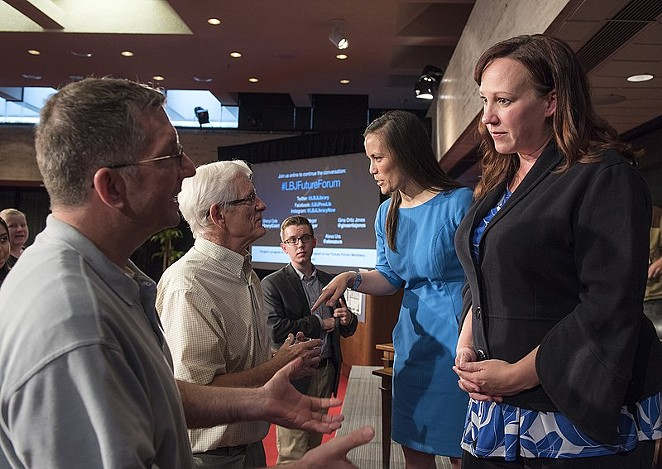 MJ Hegar (right) speaks with audience members after a 2018 political forum. - WIKIMEDIA COMMONS / JAY GODWIN