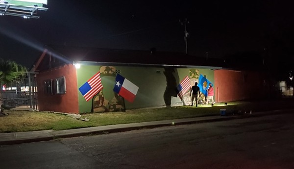 Local artist Ghost works through the night to complete a tribute mural in honor of deceased US Army soldiers Guillen and  Morales. - COURTESY CIRCLE OF ARMS