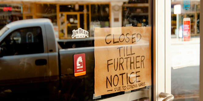 A homemade closure sign hangs in the window of a downtown San Antonio business. - AIMEE WYATT