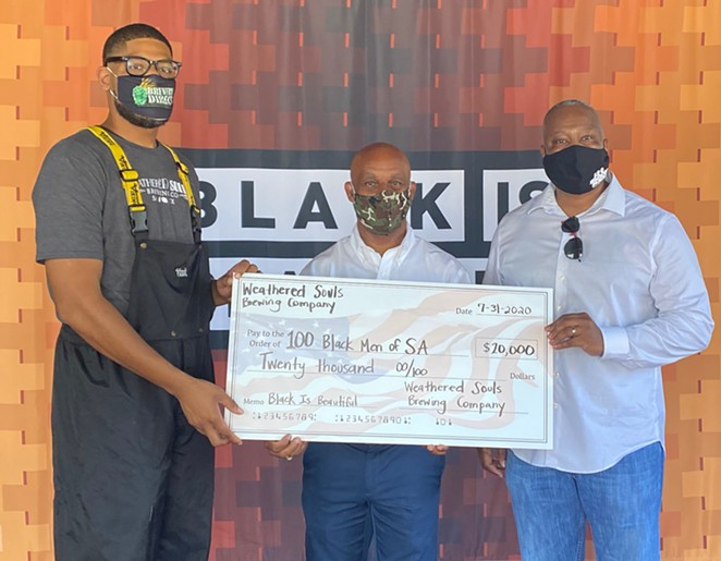 Weathered Souls founder Marcus Baskerville (L) presents a check to 100 Black Men of San Antonio President Ivory M. Freeman (C) and Executive Director Dr. Milton Harris (R). - COURTESY WEATHERED SOULS BREWING