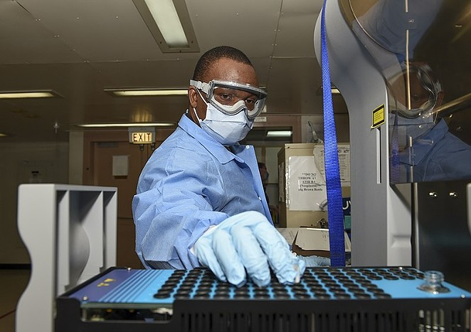 A laboratory technician  tests plasma samples. - COURTESY PHOTO / GINA ORTIZ JONES