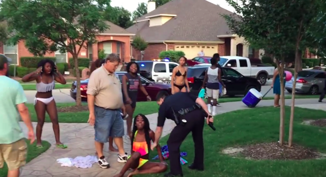 Cpl. David Eric Casebolt restrains Dajerria Becton with one hand, holding his gun in the other. - YOUTUBE SCREENGRAB
