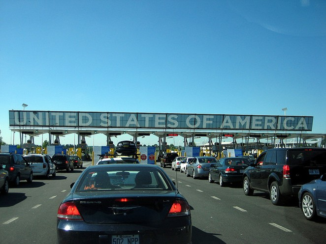 Cars line up to pass in to the U.S. - VIA FLICKR USER MPD01605