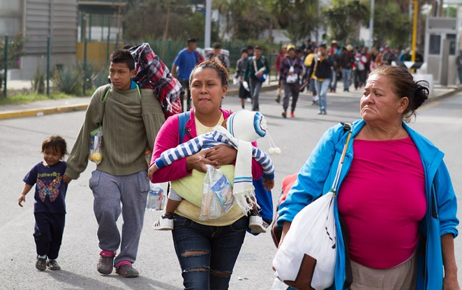 Members of a refugee caravan cross Mexico toward the U.S. border during 2018. - ALEXEI WOOD