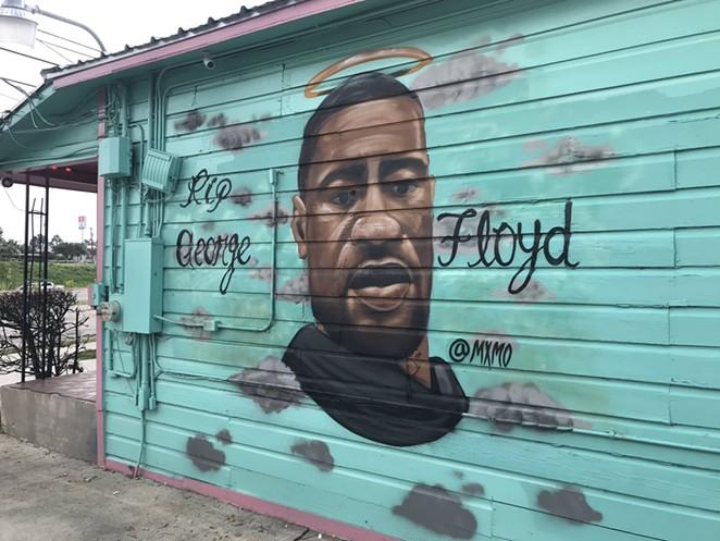A George Floyd mural adorns the side of Big Poppas Tacos on San Antonio's East Side. - TWITTER / @ALEXGAMEZTV
