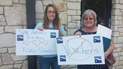 Cassandra Wilson (left) and Kim Martinic (right) were asked to leave the rally because of their signs. They were later readmitted, sans-signs. - VIA MICHAEL MARKS