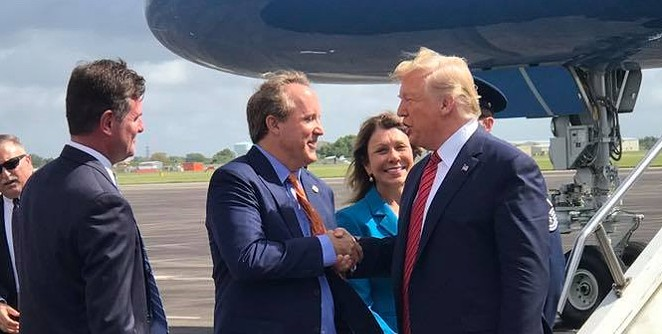 Texas AG Ken Paxton (center) does the ol' grip-and-grin with President Donald Trump during the president's visit to Houston. - FACEBOOK / KEN PAXTON