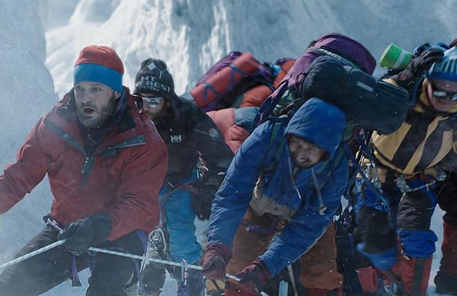 A group of climbers struggle in blizzard conditions. - COURTESY