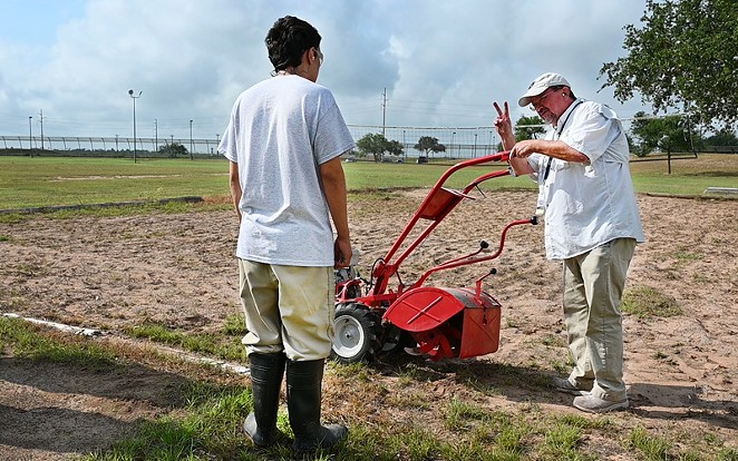 A horticulture teacher shows a youth at a TJJD facility how to safety start a garden tiller. - COURTESY PHOTO / TJJD
