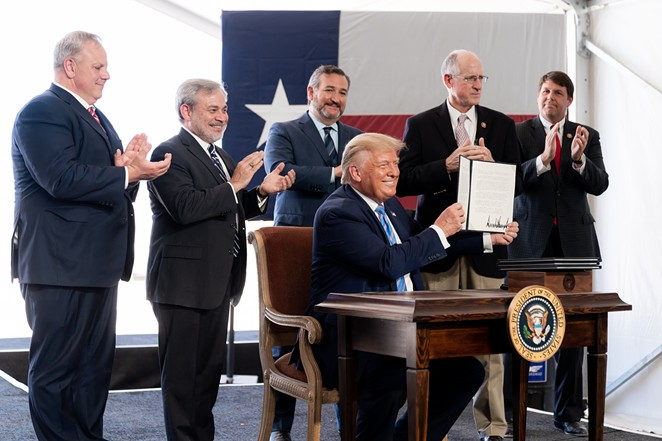 Donald Trump shows off his signature on federal permits during an appearance in Midland this summer. - COURTESY PHOTO / THE WHITE HOUSE