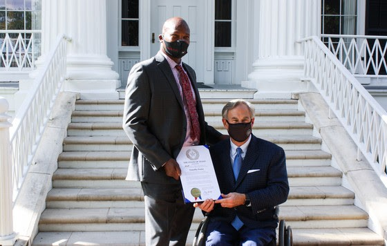 Timothy Porter of San Antonio (left) receives a recognition from Gov. Greg Abbott. - OFFICE OF THE GOVERNOR