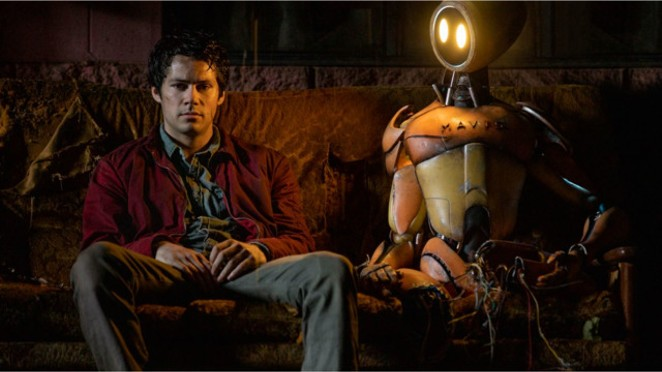 Joel (Dylan O'Brien) is dealing with the end of the world, the death of his parents and the loss of his love. But at least he has a companion robot to keep him company. - PARAMOUNT PICTURES