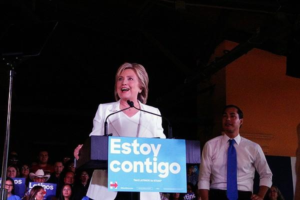 Hillary Clinton speaks as Julian Castro looks on at a rally on Thursday at Sunset Station. - GABBY MATA