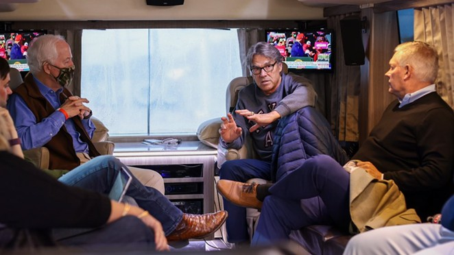 John Cornyn (left) and Rick Perry (center) converse in the senator's campaign bus on the way to College Station. - TWITTER / @TEAMCORNYN