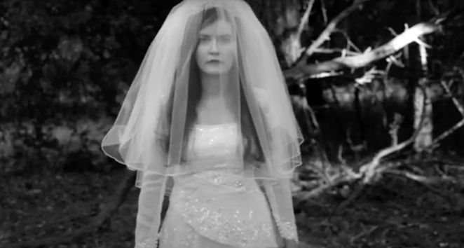 Hyperbubble singer Jessica walks through the woods in the duo's eerie new video. - YOUTUBE CAPTURE / HYPERBUBBLE