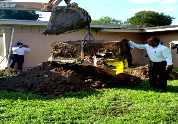 A coffin was found buried in a backyard on Elm St. - DEEDEE OLIVEIRA
