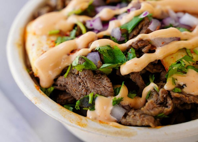 Coreanos' B.A.P features seasoned rice, marinated beef bulgogi, spicy marinated chicken with onions, cilantro, cheese and El Scorcho sauce. - COURTESY COREANOS