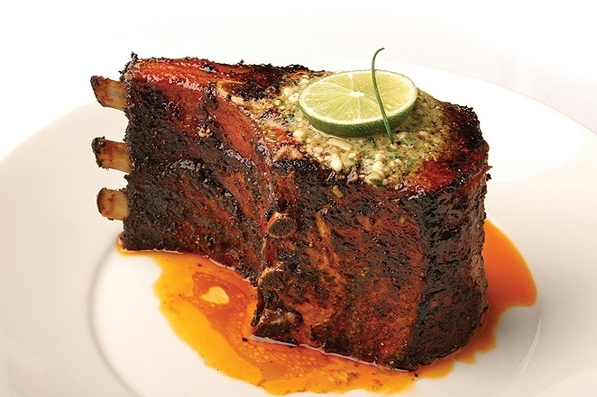 Perry's Flinstonian pork chop is only $13.95 during lunch on Fridays. - FILE PHOTO