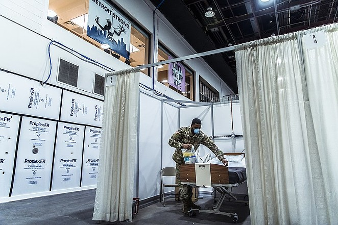A solider helps prepare a room in a temporary hospital facility in Detroit to handle overflow COVID-19 patients. - WIKIMEDIA COMMONS / NATIONAL GUARD