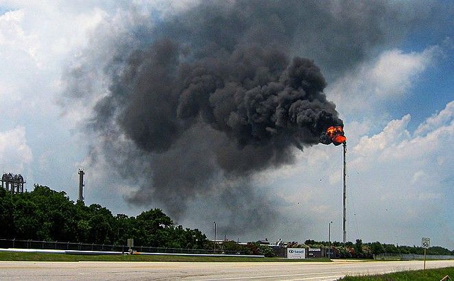 Gas flares above the Bayport Industrial District in Harris County. - WIKIMEDIA COMMONS / JIM EVANS