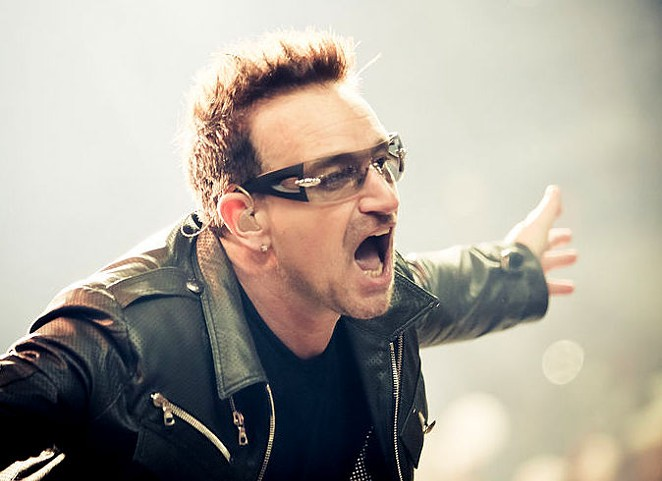 """Gimme some fookin' money for the homeless people, ya shite!"" is what Bono is probably not saying. - VIA WIKIPEDIA"