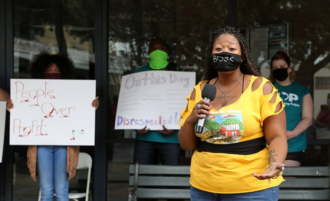 Alazán Courts resident Jacquline Caldwell speaks at a protest in front of SAHA headquarters on Saturday. - BEN OLIVO / SA HERON