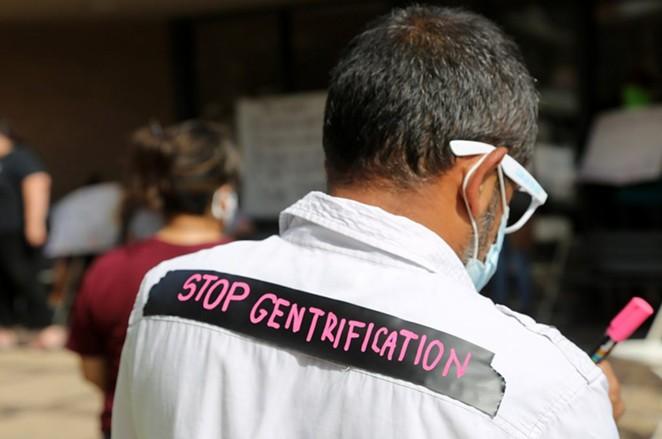 A protestor attends a rally Saturday at SAHA headquarters. - BEN OLIVO / SA HERON