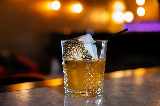The Campfire Marshmallow Old Fashioned is topped with a flame-toasted marshmallow. - KODY MELTON