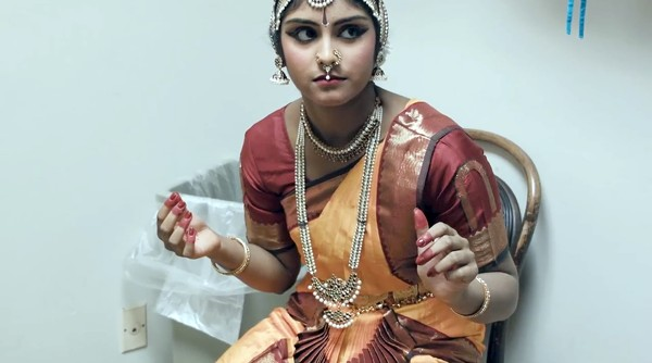Bharatanatyam dance student Gayathri Evani gets ready backstage for her performance captured in the documentary short film Of Gods and Bells. - COURTESY