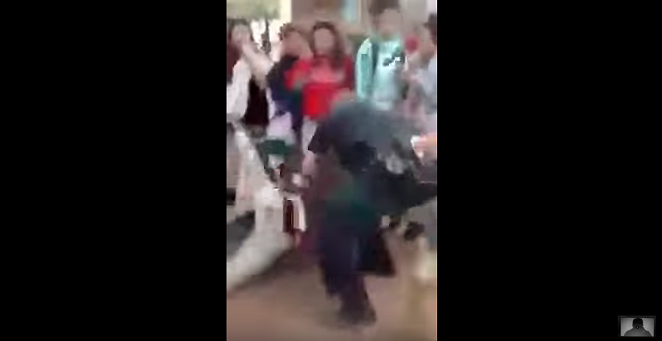 Screenshot of the video showing an SAISD video slam a girl to the ground. - YOUTUBE SCREENSHOT/GHOST-0