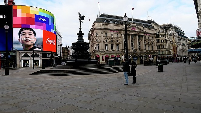 London's Piccadilly Circus is shown almost deserted during a coronavirus lockdown in October. - WIKIMEDIA COMMONS / KWH1050