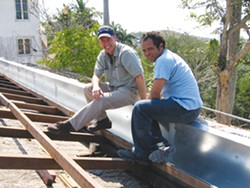 William Dupont and Cuban architect Adanelio Benavides Ramos review the roof and gutter assembly on Hemingway's House in 2006.