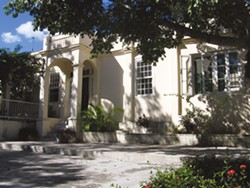 The front door to Finca Vigia; a rendering of the archival facility by The Christian Company