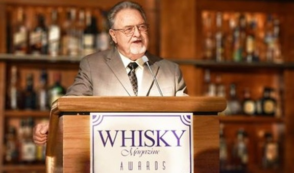 Master Distiller Emeritus Willie Pratt accepts his induction to The Whisky Magazine Hall of Fame in 2017. - COURTESY MICHTER'S