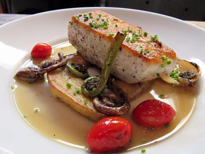 Alaskan halibut, one of the new menu items at Tre Enoteca - COURTESY