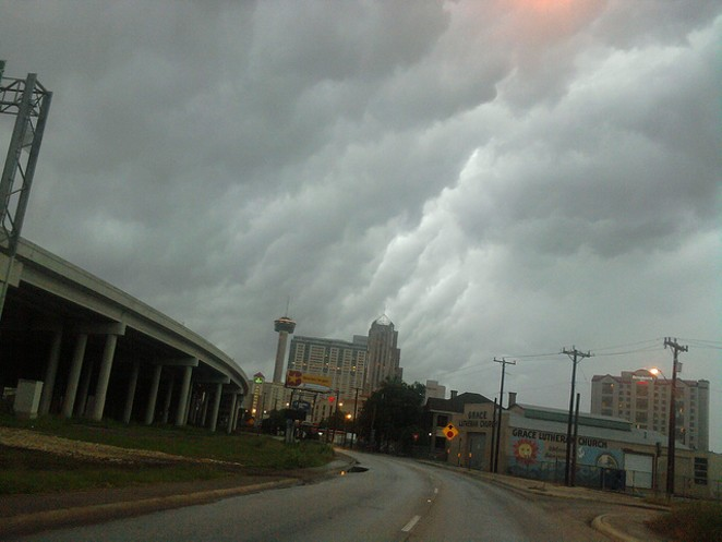 Storm clouds gather over Downtown. - FLICKR CREATIVE COMMONS/JOHN TEDESCO