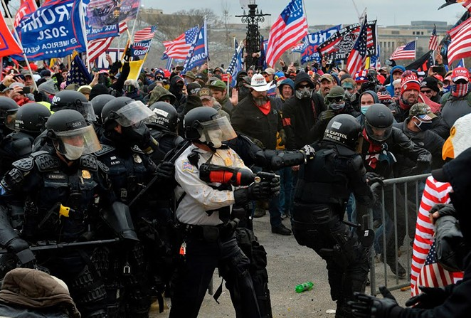 A pro-Trump mob overruns barricades at the U.S. Capitol during last Wednesday's insurrection. - SHUTTERSTOCK