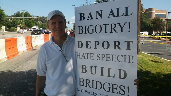 Mick Sullivan holds up a sign he made for the protest. - MICHAEL MARKS