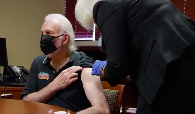 Spurs Coach Gregg Popovich receives a COVID-19 vaccine in a new public service announcement. - SCREEN CAPTURE / NBA CARES