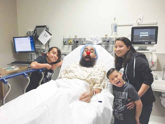 Earlier this year, doctors at University Hospital removed Larry Garza's entire right kidney and the middle lobe of his lung. - COURTESY LARRY GARZA