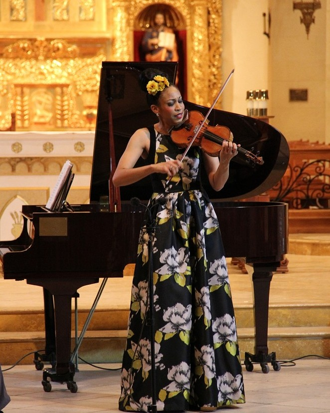A violinist performs as part of one of MBAW's free concerts at the San Fernandro Cathedral. - COURTESY OF MUSICAL BRIDGES AROUND THE WORLD