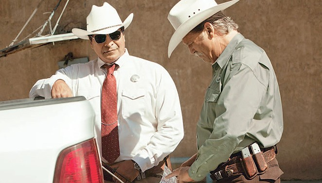 Texas Rangers Alberto Parker (Birmingham) and Marcus Hamilton (Bridges) hunt down a pair of West Texas bank robbers in Hell or High Water. - CBS FILMS