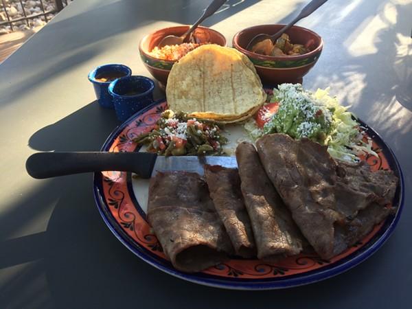 Cecina Asada de Yecapixtla with nopalitos, tortillas, guacamole, salsa, and sides