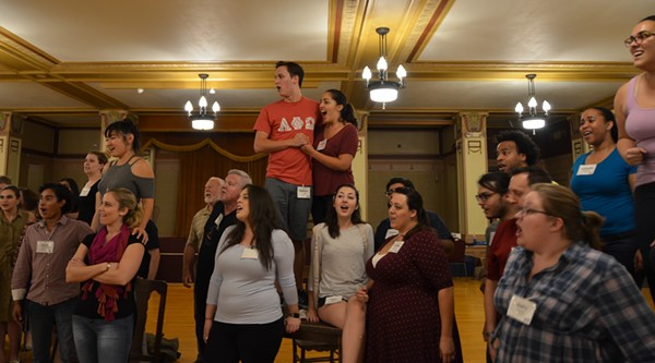 Chorus members performing the Act II finale